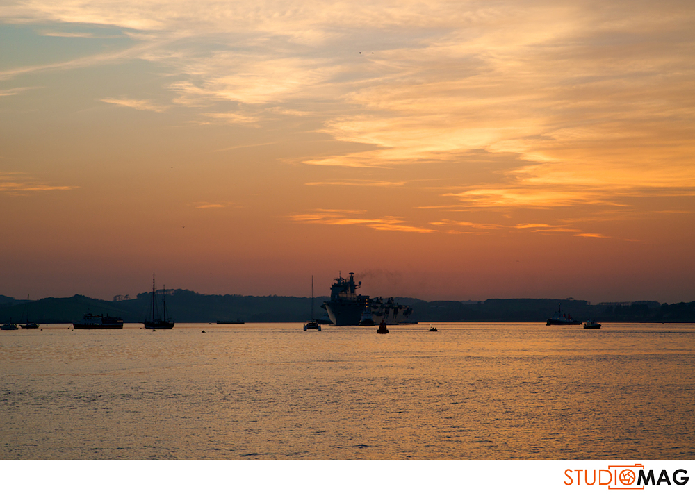 sunset behind navy ship from Royal William Yard